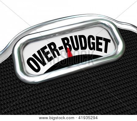 The words Over-Budget on a scale, illustrating financial problems such as debt, deficit, over spending, lack of savings, bankruptcy and other economic trouble