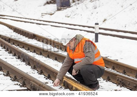 Railroad worker with adjustable wrench in the hand