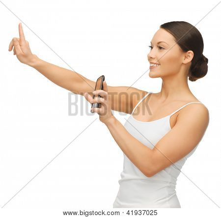 woman holding smartphone and working with something imaginary