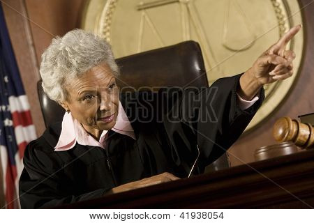 Portrait of senior judge explaining in courtroom