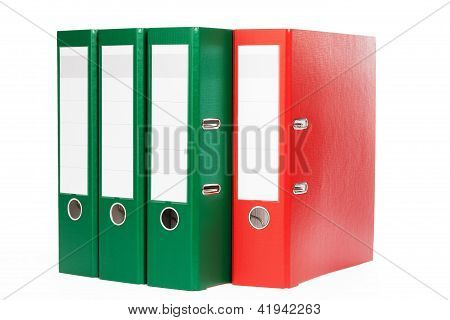 three green and one red ring binders