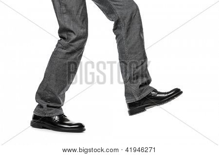 Business man in black shoes walking for next achievement or promotion step white isolated