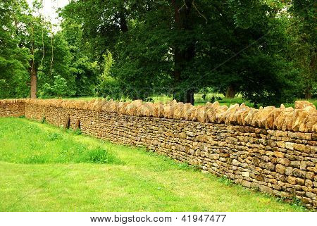 Countryside garden, stone wall
