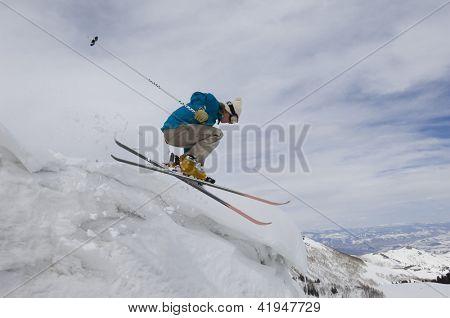 Female skier jumping in midair