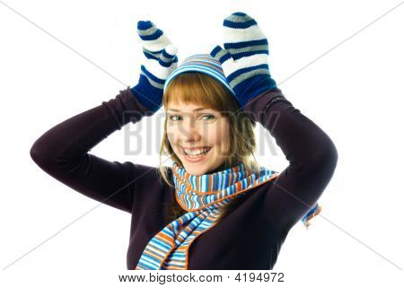 Playful Girl Wearing Mittens, Warm Hat And Scarf