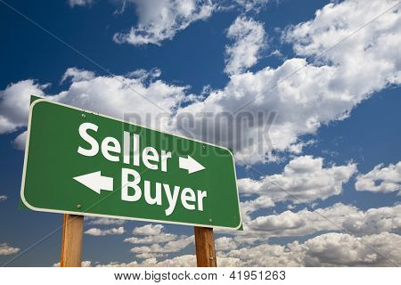 Seller, Buyer Green Road Sign Over Dramatic Clouds and Sky.