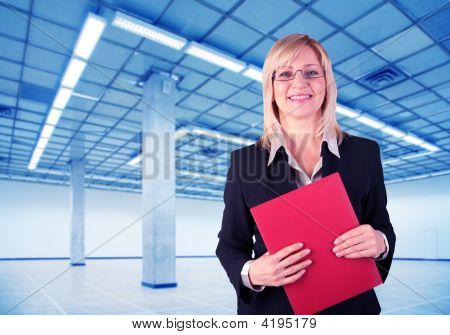 Businesswoman And Empty Hall With Columns