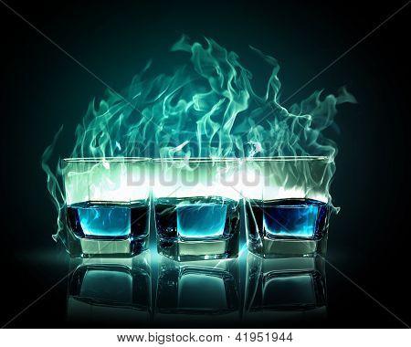 Three glasses of burning emerald absinthe