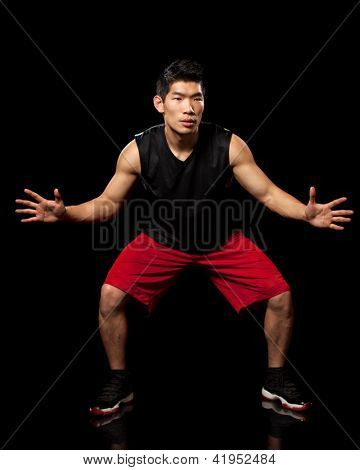 Male basketball player. Studio shot over black.