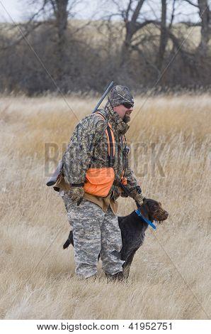 Hunter commanding his dog