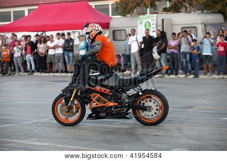Motorcyclist Performing Extreme Stand