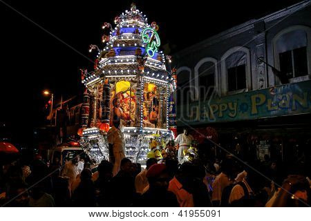 KUALA LUMPUR - JANUARY 26: A chariot with a Hindu god, Lord Muruga passes the streets of Kuala Lumpur, Malaysia on its 15km pilgrimage to Batu Caves on January 26, 2013 to start Thaipusam festival.