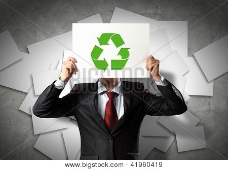 Image of man holding board with recycling sign