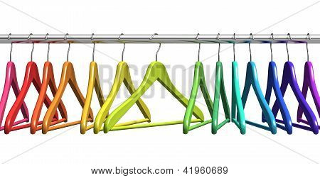 Rainbow coat hangers on clothes rail