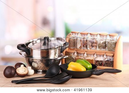 composition of kitchen tools,spices and vegetables on table in kitchen