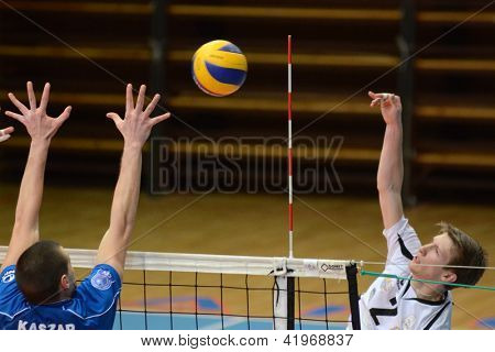 KAPOSVAR, HUNGARY - FEBRUARY 1: Bence Bozok (R) in action at a Middle European League volleyball game Kaposvar HUN (w) vs Innsbruck AUT (b), February 1, 2013 in Kaposvar, Hungary