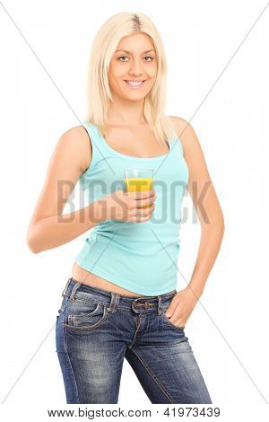 Young smiling woman holding a glass of orange juice isolated against white background