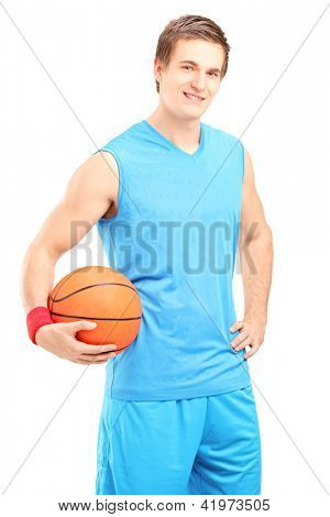 A smiling basketball player posing with a ball in his hand isolated on white background