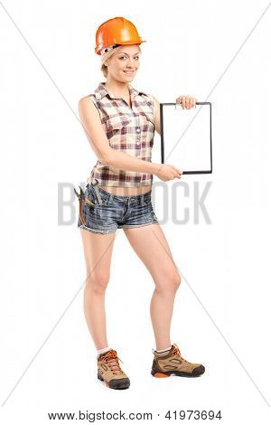 Full length portrait of a female worker showing a blank clipboard isolated against white background