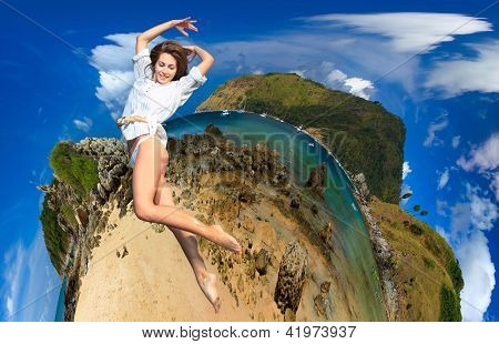 Girl jumping on Exotic Bay in Phuket island Thailand