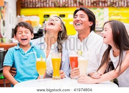Happy family at the diner enjoying together and laughing