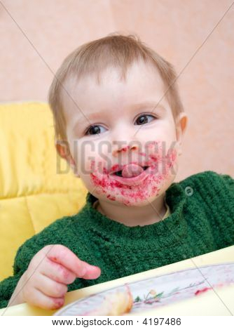 Child Eating Pie With Currant.