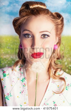 Retro Blond Woman Blowing Dandelion Seeds