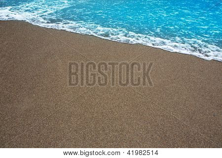 beach tropical shore with brown sand and clear water wave
