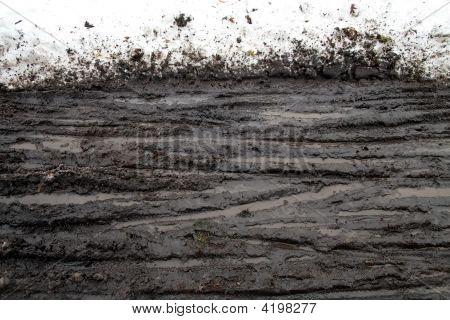 Snow Mud And Tracks
