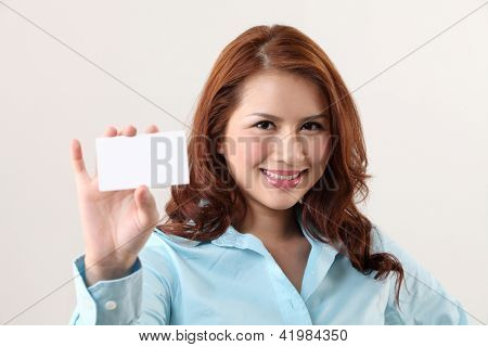 Business woman holding a card