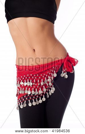 Belly Dancer Wearing a Red Coin Belt and Workout Clothing