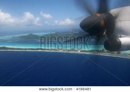 Plane Over Pacific Island