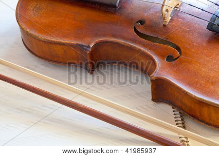 Fiddle Bout And Bow On Music Book