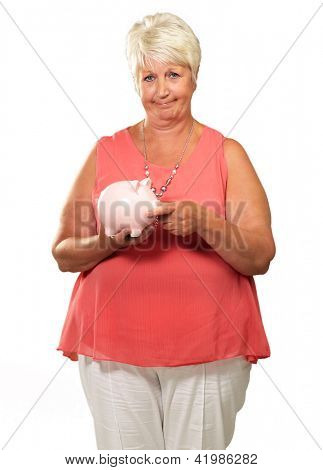 Woman Putting Coin In Piggy Bank Isolated On White Background