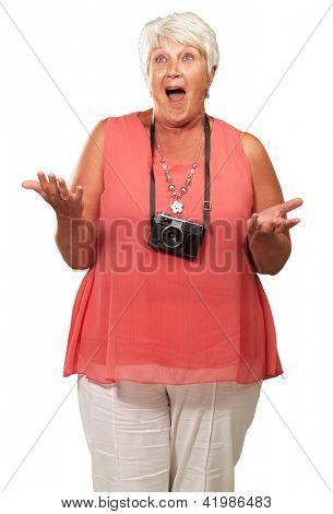 Senior Woman Wearing Camera Shrugging Isolated On White Background