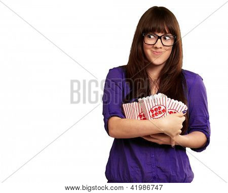 Portrait Of A Girl Holding Popcorn Packets And Smiling On White Background