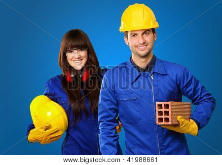 Portrait Of Two Happy Engineers Isolated On Blue Background