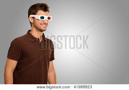 Happy Young Man Wearing 3d Glasses Isolated On Grey Background