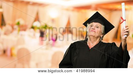 Senior Woman Holding Graduation Certificate, Indoors
