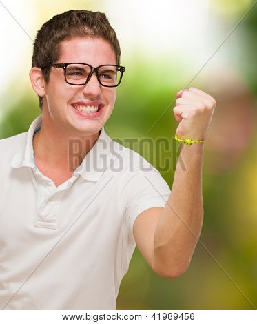Young Man Showing His Fist against a nature background