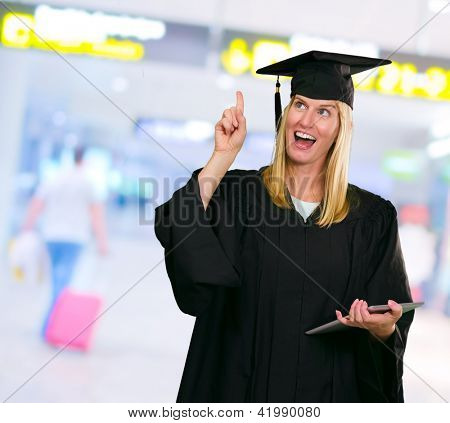 Graduate Woman Holding Digital Tablet at the airport