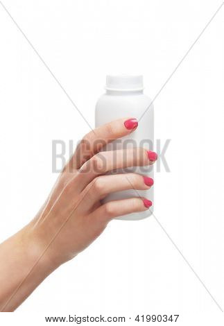 Beautiful female hands with the talcum powder isolated on white