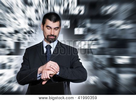 Businessman over abstract business collage