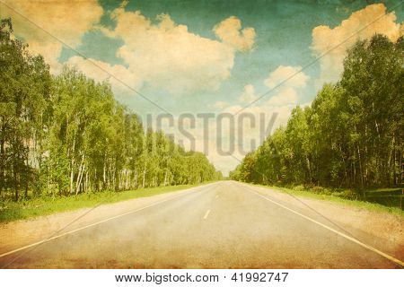 Landscape with asphalt road in grunge and retro style.