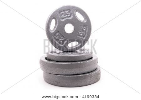 Dumbbell Weights Stacked On White