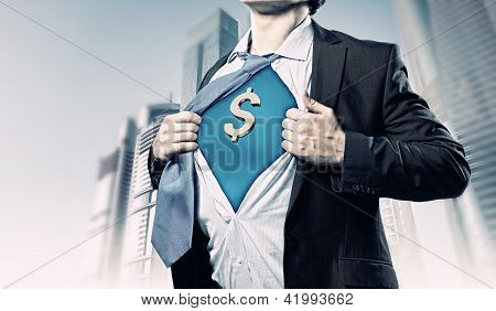 Businessman showing superman suit underneath shirt