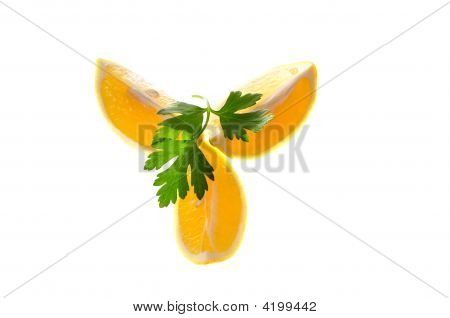 Three Slices Of Lemon With Parsley