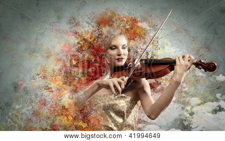 Gorgeous woman playing on violin