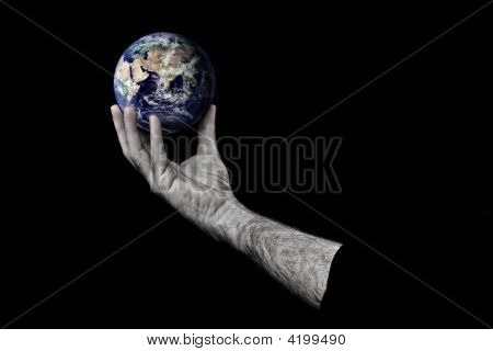 Man Holding Planet Earth