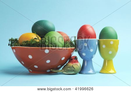 Happy Easter Still Life With Rainbow Color Eggs In Orange Polka Dot Bowl